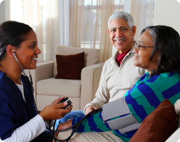 caregiver checking blood pressure of an elder