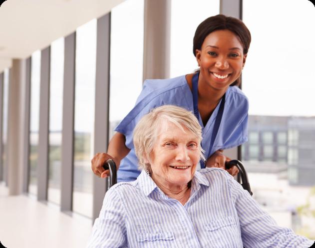 caregiver assisting an elder in a wheelchair